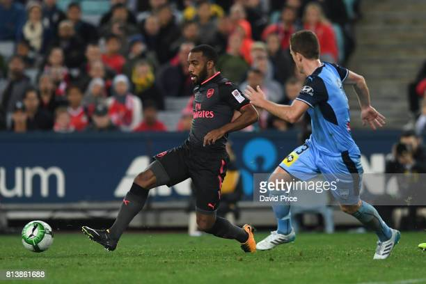 Alexandre Lacazette of Arsenal passes the ball under pressure from Brandon O'Neill of Sydney during the match between Sydney FC and Arsenal at ANZ...