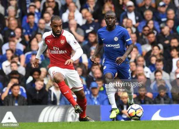 Alexandre Lacazette of Arsenal passes the ball under pressure from N'Golo Kante of Chelsea during the Premier League match between Chelsea and...