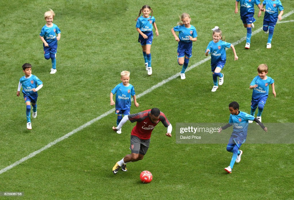 Alexandre Lacazette of Arsenal plays football with the Junior Gunners after the Arsenal Training Session at Emirates Stadium on August 3, 2017 in London, England.
