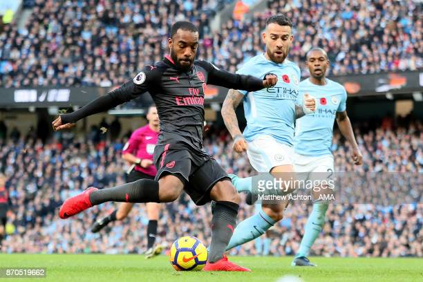 Alexandre Lacazette of Arsenal scores a goal to make the score 21 during the Premier League match between Manchester City and Arsenal at Etihad...