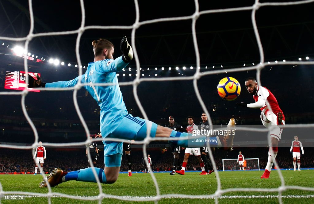 Alexandre Lacazette of Arsenal scores his sides first goal during the Premier League match between Arsenal and Manchester United at Emirates Stadium on December 2, 2017 in London, England.