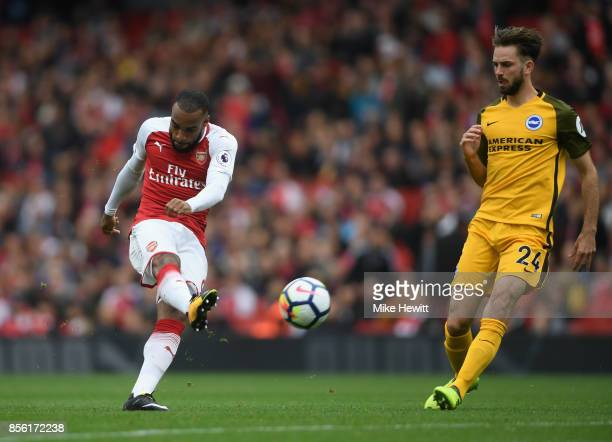 Alexandre Lacazette of Arsenal shoots during the Premier League match between Arsenal and Brighton and Hove Albion at Emirates Stadium on October 1...