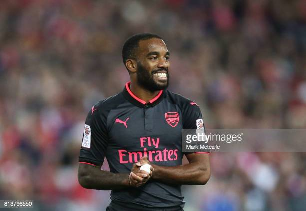 Alexandre Lacazette of Arsenal smiles during the match between Sydney FC and Arsenal FC at ANZ Stadium on July 13 2017 in Sydney Australia