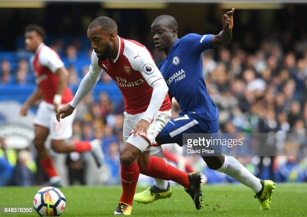 Alexandre Lacazette of Arsenal takes on N'Golo Kante of Chelsea during the Premier League match between Chelsea and Arsenal at Stamford Bridge on...