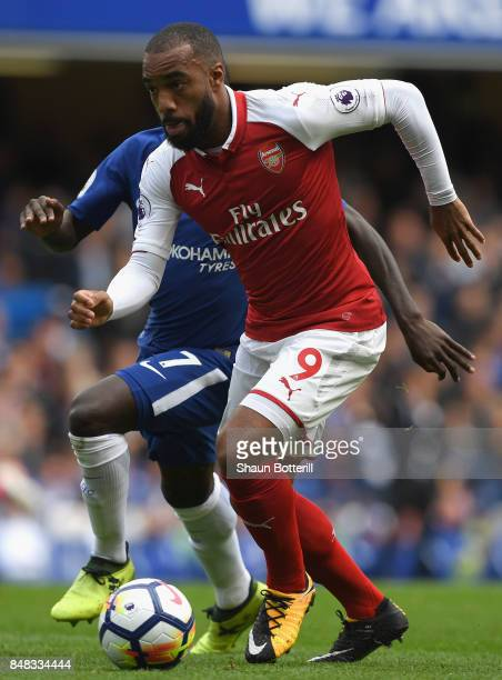 Alexandre Lacazette of Arsenal takes the ball away from N'Golo Kante of Chelsea during the Premier League match between Chelsea and Arsenal at...