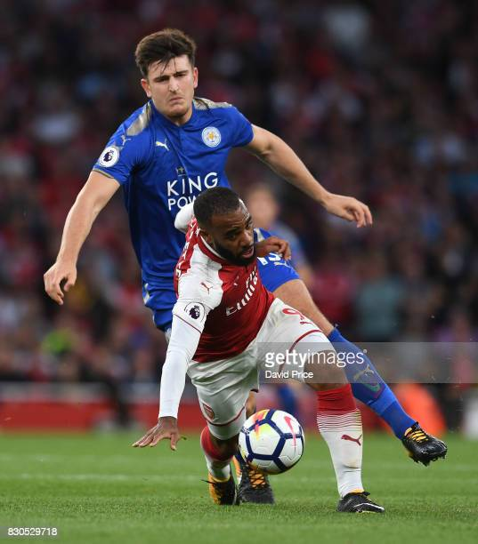 Alexandre Lacazette of Arsenal turns away from Harry MaGuire of Leicester during the Premier League match between Arsenal and Leicester City at...