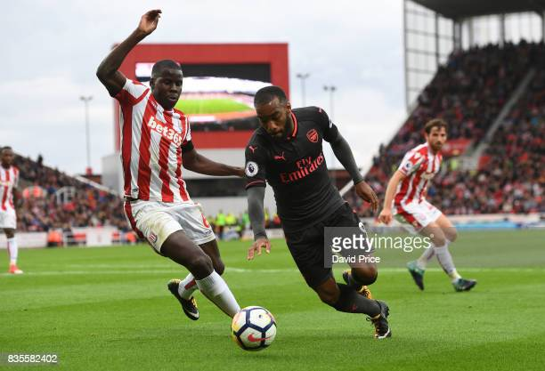 Alexandre Lacazette of Arsenal turns away from Kurt Zouma of Stoke during the Premier League match between Stoke City and Arsenal at Bet365 Stadium...