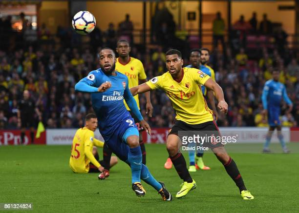 Alexandre Lacazette of Arsenal under pressure from Adrian Mariappa of Watford during the Premier League match between Watford and Arsenal at Vicarage...