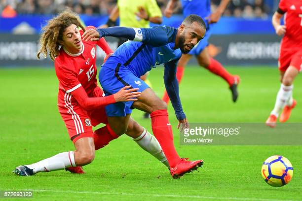 Alexandre Lacazette of France and Ethan Ampadu of Wales during the international friendly match between France and Wales at Stade de France on...