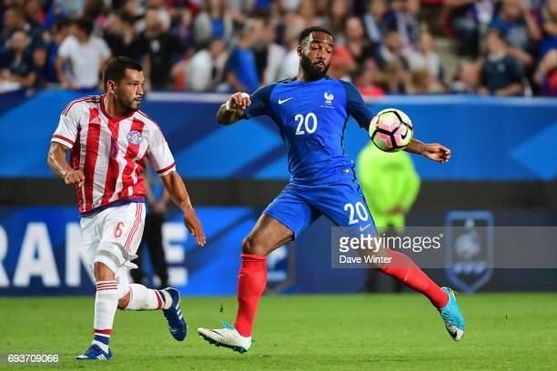 Alexandre Lacazette of France and Miguel Samudio of Paraguay during the soccer friendly match between France and Paraguay at Roazhon Park on June 2...