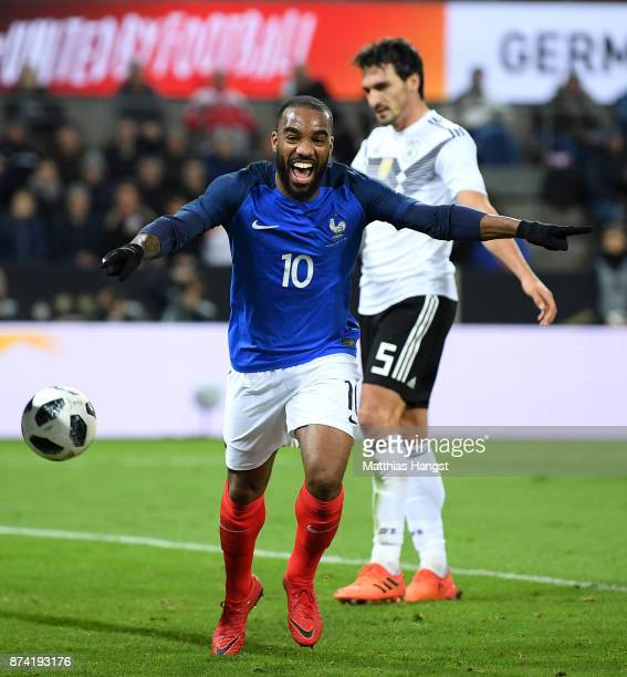 Alexandre Lacazette of France celebrates scoring his sides first goal during the international friendly match between Germany and France at...