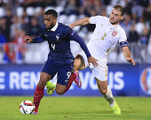 Alexandre Lacazette of France is challenged by Branislav Ivanovic of Serbia during the International friendly match between Serbia and France at the...