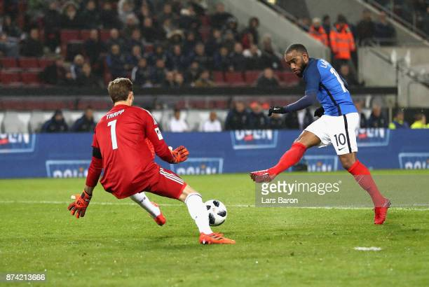Alexandre Lacazette of France scores his sides second goal past Kevin Trapp of Germany during the international friendly match between Germany and...