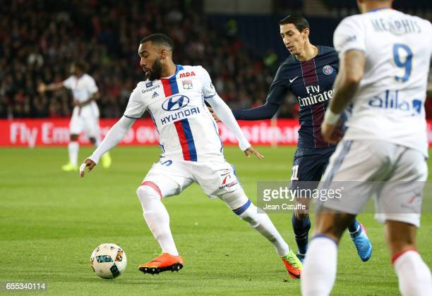 Alexandre Lacazette of Lyon and Angel Di Maria of PSG in action during the French Ligue 1 match between Paris SaintGermain and Olympique Lyonnais at...