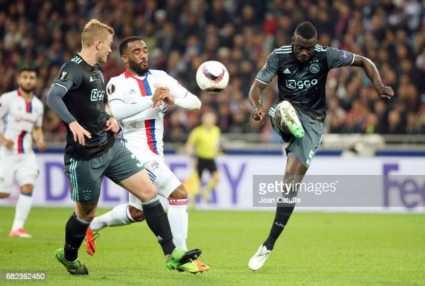 Alexandre Lacazette of Lyon and Davinson Sanchez of Ajax Amsterdam during the UEFA Europa League semi final second leg match between Olympique...