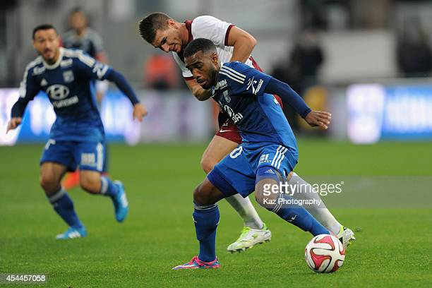 Alexandre Lacazette of Lyon and Jeremy Chopilin of Metz compete for the ball during the French Ligue 1 match between FC Metz and Olympique Lyonnais...