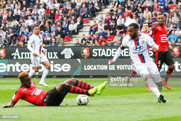 Alexandre Lacazette of Lyon and Joris Gnagnon of Rennes during the French Ligue 1 match between Rennes and Lyon at Roazhon Park on April 2 2017 in...