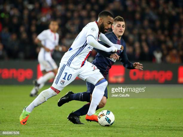 Alexandre Lacazette of Lyon and Marco Verratti of PSG in action during the French Ligue 1 match between Paris SaintGermain and Olympique Lyonnais at...