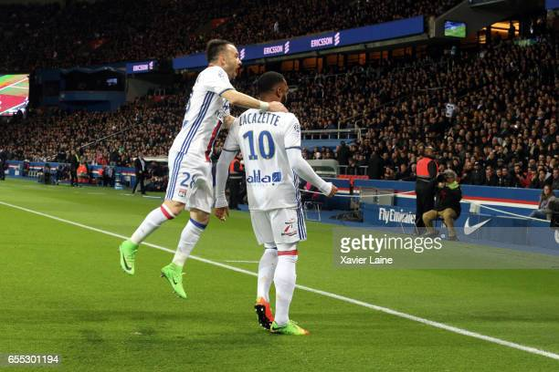Alexandre Lacazette of Lyon celebrate his goal with Mathieu Valbuena during the French Ligue 1 match between Paris Saint Germain and Lyon OL at Parc...