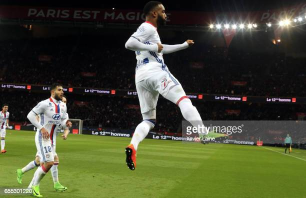 Alexandre Lacazette of Lyon celebrate his goal with teammattes during the French Ligue 1 match between Paris Saint Germain and Lyon OL at Parc des...
