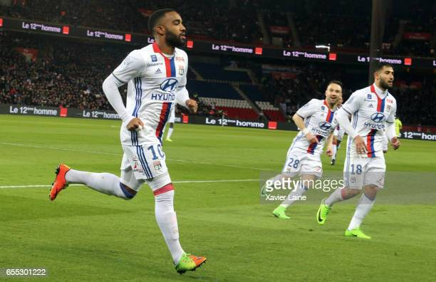Alexandre Lacazette of Lyon celebrate his goal with teammattes during the French Ligue 1 match between Paris Saint Germain and Lyon OL at Parc des...