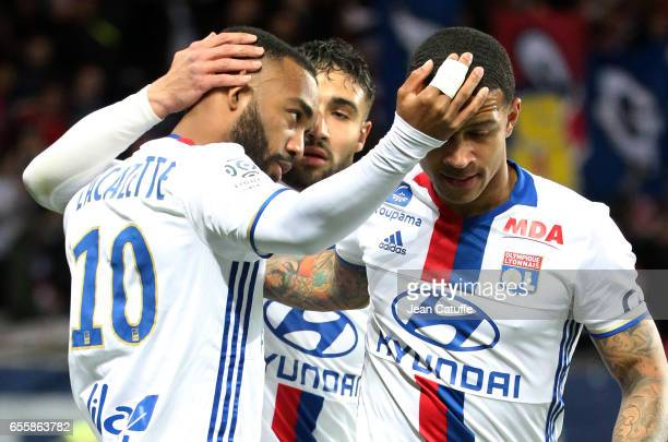 Alexandre Lacazette of Lyon celebrates his goal with Nabil Fekir and Memphis Depay during the French Ligue 1 match between Paris SaintGermain and...