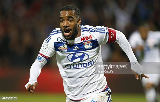 Alexandre Lacazette of Lyon celebrates his second goal during the French Ligue 1 match between Olympique Lyonnais and AS SaintEtienne at Stade de...