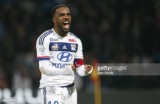 Alexandre Lacazette of Lyon celebrates the victory at the end of the French Ligue 1 match between Olympique Lyonnais and AS SaintEtienne at Stade de...