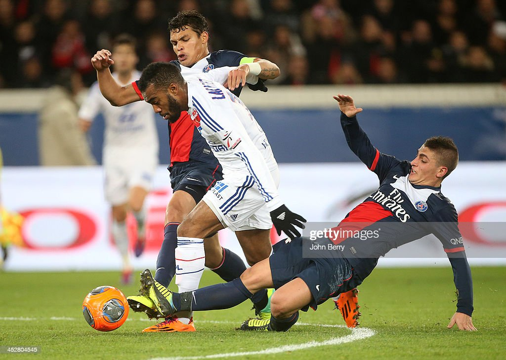<a gi-track='captionPersonalityLinkClicked' href=/galleries/search?phrase=Alexandre+Lacazette&family=editorial&specificpeople=6927653 ng-click='$event.stopPropagation()'>Alexandre Lacazette</a> of Lyon in action between Thiago Silva and <a gi-track='captionPersonalityLinkClicked' href=/galleries/search?phrase=Marco+Verratti&family=editorial&specificpeople=7256509 ng-click='$event.stopPropagation()'>Marco Verratti</a> of PSG during the french Ligue 1 match between Paris Saint-Germain FC and Olympique Lyonnais at the Parc des Princes stadium on December 1, 2013 in Paris, France.