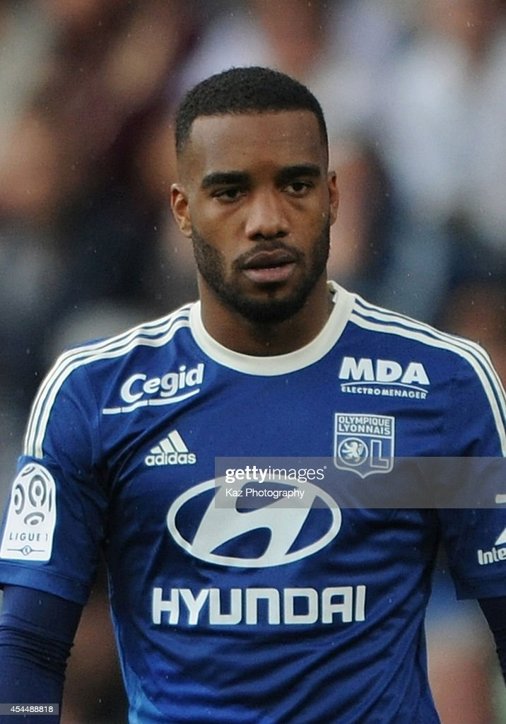 <a gi-track='captionPersonalityLinkClicked' href=/galleries/search?phrase=Alexandre+Lacazette&family=editorial&specificpeople=6927653 ng-click='$event.stopPropagation()'>Alexandre Lacazette</a> of Lyon in action during the French Ligue 1 match between FC Metz and Olympique Lyonnais at Stade Saint-Symphorien on August 31, 2014 in Metz, France.