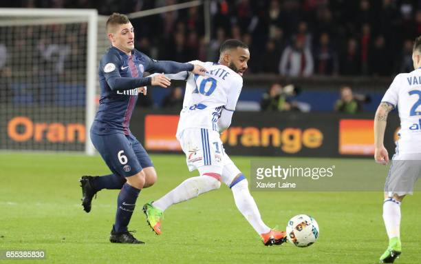 Alexandre Lacazette of Lyon in action with Marco Verratti of Paris SaintGermain during the French Ligue 1 match between Paris Saint Germain and Lyon...
