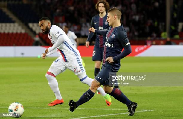 Alexandre Lacazette of Lyon in action with Marco Verrattiof PSG during the French Ligue 1 match between Paris Saint Germain and Lyon OL at Parc des...
