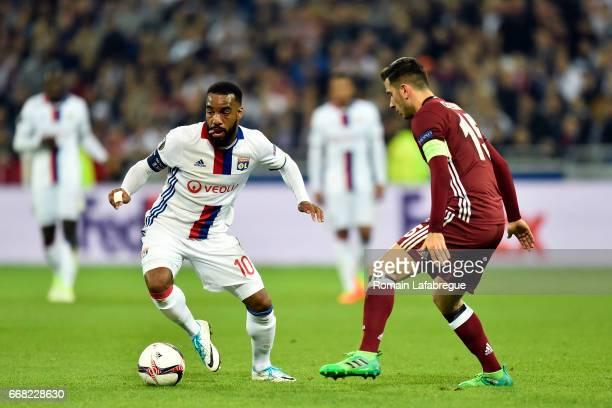 Alexandre Lacazette of Lyon Oguzhan Ozyakup of Besiktas during the Uefa Europa League quarter final first leg match between Olympique Lyonnais Lyon...