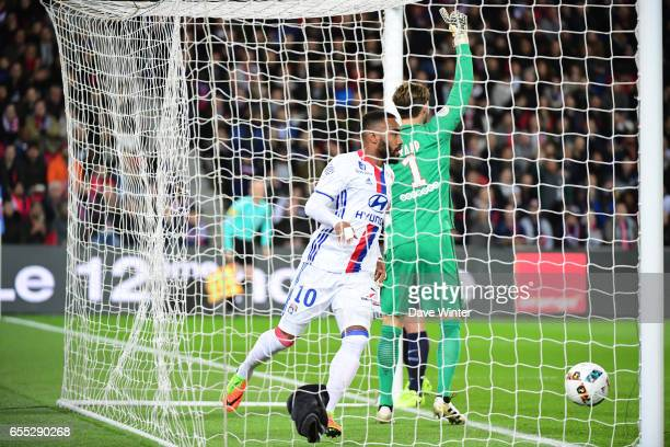 Alexandre Lacazette of Lyon puts his side 10 ahead during the French Ligue 1 match between Paris Saint Germain and Lyon at Parc des Princes on March...