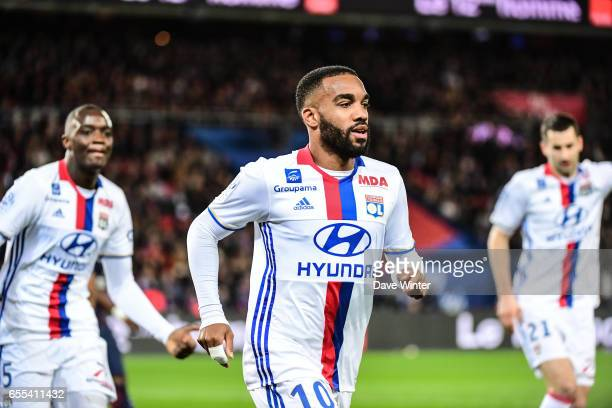 Alexandre Lacazette of Lyon puts his side 10 ahead during the French Ligue 1 match between Paris Saint Germain and Lyon at Parc des Princes on March...