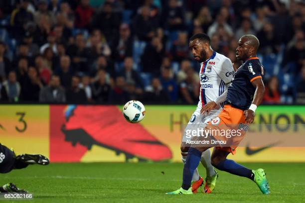 Alexandre Lacazette of Lyon scores the second goal and Yacouba Sylla of Montpellier during the Ligue 1 match between Montpellier and Olympique...