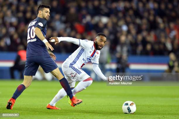 Alexandre Lacazette of Olympique Lyonnais and Javier Pastore of Paris SaintGermain fight for the ball during the French Ligue 1 match between Paris...