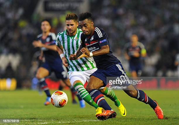 Alexandre Lacazette of Olympique Lyonnais and Markus Steinhofer of Real Betis Balompie in action during the UEFA Europa League group stage match...