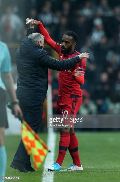 Alexandre Lacazette of Olympique Lyonnais celebrates with his head coach Bruno Genesio after scoring during the UEFA Europa League quarter final...