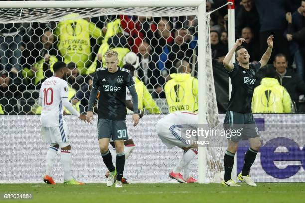 Alexandre Lacazette of Olympique Lyonnais Donny van de Beek of Ajax Rachid Ghezzal of Olympique Lyonnais Nick Viergever of Ajaxduring the UEFA Europa...