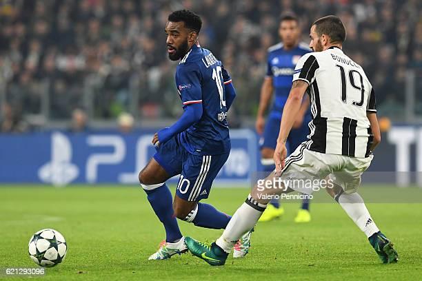 Alexandre Lacazette of Olympique Lyonnais in action against Leonardo Bonucci of Juventus during the UEFA Champions League Group H match between...