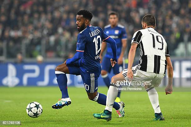 Alexandre Lacazette of Olympique Lyonnais in action against Leonardo Bonucci of Juventus during the UEFA Champions League Group H match between...