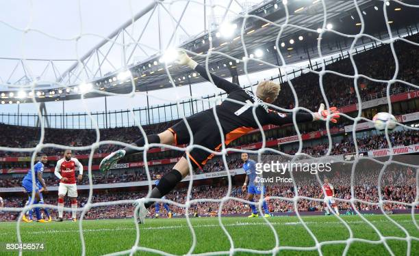 Alexandre Lacazette scores Arsenal's 1st goal past Kasper Schmeichel of Leicester during the Premier League match between Arsenal and Leicester City...
