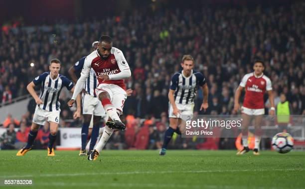 Alexandre Lacazette scores his and Arsenal's 2nd goal from the penalty spot during the Premier League match between Arsenal and West Bromwich Albion...