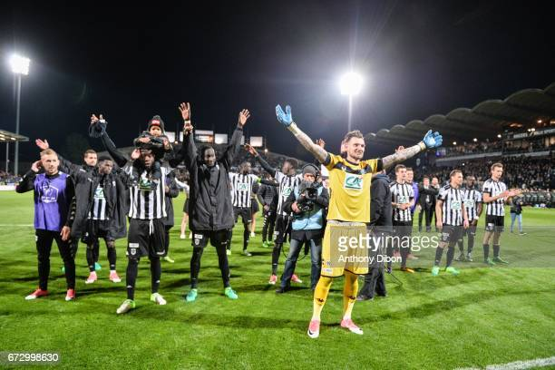 Alexandre Letellier goalkeeper of Angers celebrates the victory with his team mate and fans during the Semi final of the French Cup match between...