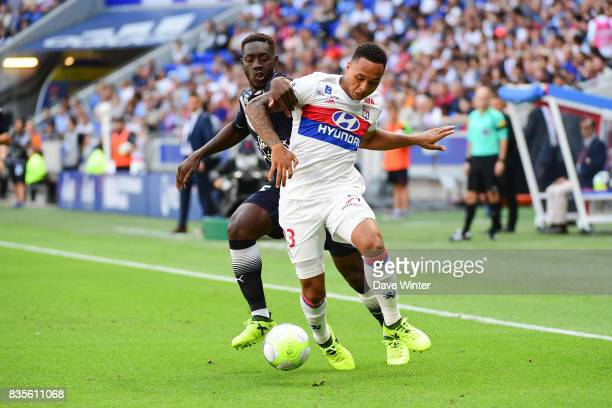 Alexandre Mendy of Bordeaux and Kenny Tete of Lyon during the Ligue 1 match between Olympique Lyonnais and FC Girondins de Bordeaux at Groupama...