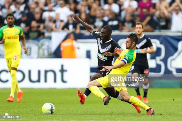 Alexandre Mendy of Bordeaux and Leo Dubois of Nantes during the Ligue 1 match between FC Girondins de Bordeaux and FC Nantes at Stade Matmut...