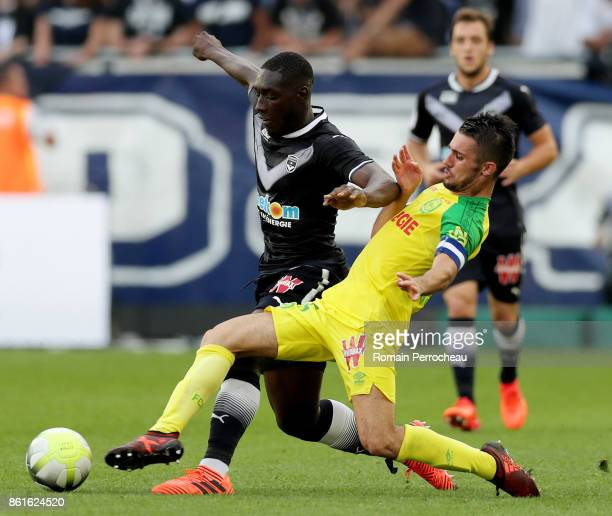 Alexandre Mendy of Bordeaux and Leo Dubois of Nantes in action during the Ligue 1 match between FC Girondins de Bordeaux and FC Nantes at Stade...