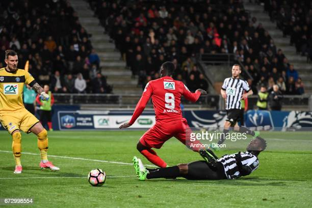 Alexandre Mendy of Guingamp tackle by Ismael Traore of Angers during the Semi final of the French Cup match between Angers and Guingamp at Stade Jean...