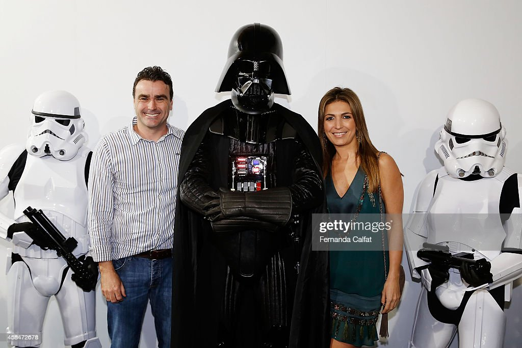 Alexandre Menegotti and Margareth Menegotti pose for a photo with costume members of Star Wars before the Triton fashion show during Sao Paulo...